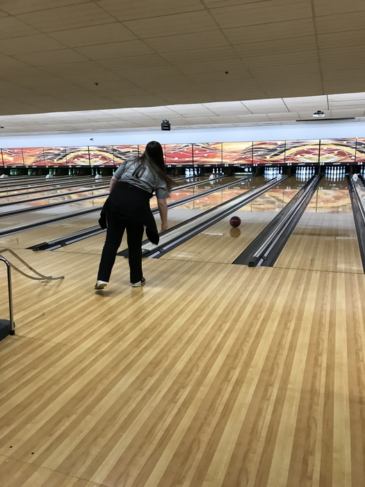 Bella knocking pins out in bowling.