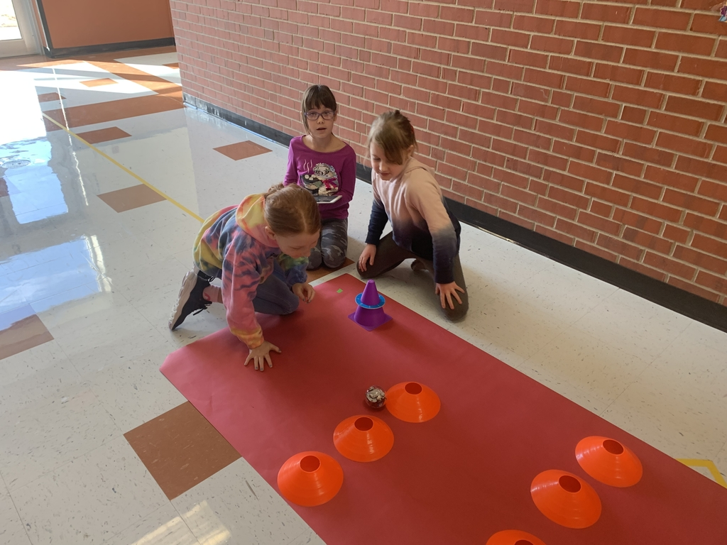 Third graders try to get a bolt around an obstacle.